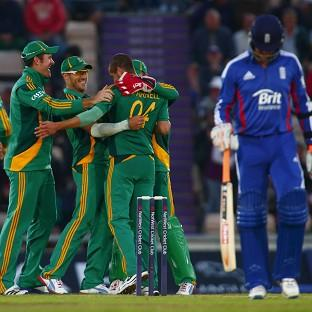 South Africa celebrate taking the wicket of Jonathan Trott