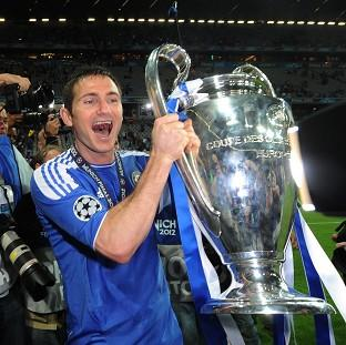 Frank Lampard celebrates Chelsea's Champions League triumph last season