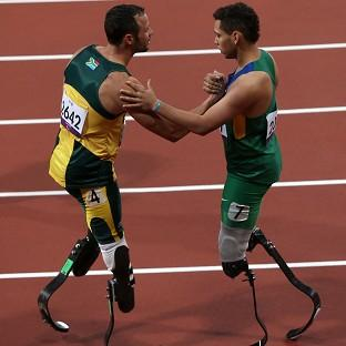 Oscar Pistorious, left, congratulated Alan Fonteles Oliveira on his victory, but later complained about the length of the Brazilian's blades