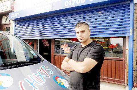 Shazad Iqbal outside Chixy's Chicken