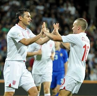 Frank Lampard, left, celebrates scoring England's first goal with Tom Cleverley