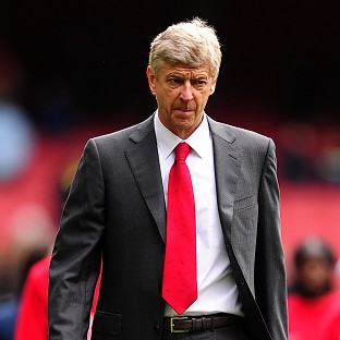 Arsene Wenger is in no rush to sign a new deal