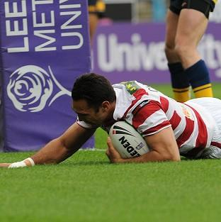 George Carmont scored a hat-trick of tries in Wigan's rout of Catalan