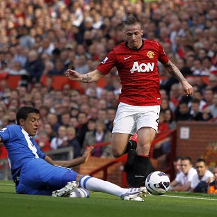 Alexander Buttner, right, was on target as Manchester United claimed a 3-0 victory over Wigan