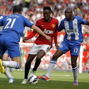 Roberto Martinez believes Danny Welbeck, centre, should have been sent off during Saturday's clash