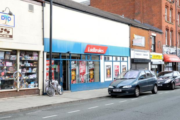Ladbrokes betting shop on Elliott Street where a man wielding an iron bar burst in, threatened staff and stole cash