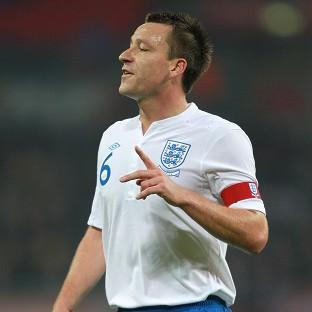 The Bolton News: John Terry has quit international football