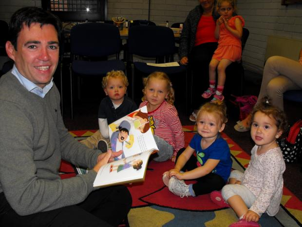 MP Andy Burnham at under fives' storytelling session at Golborne Library