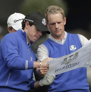 The Bolton News: Rory McIlroy, left, is focussing on the whole team at the Ryder Cup (AP)