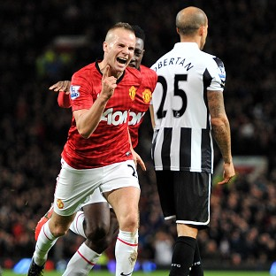 Tom Cleverley celebrates scoring Manchester United's second goal