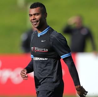 Ashley Cole, who is expected to incur an FA fine, trains at St George's Park