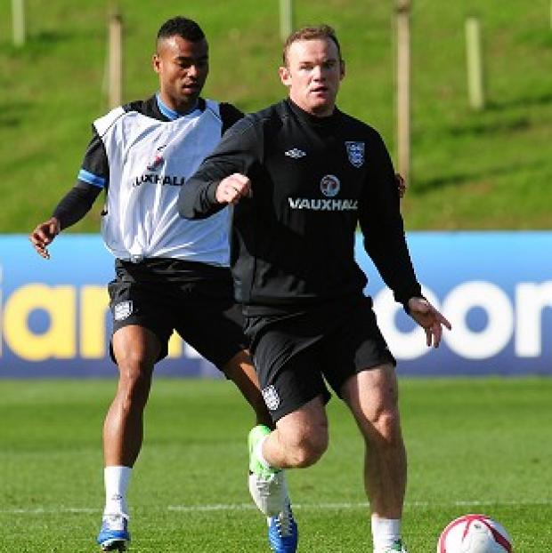 The Bolton News: Wayne Rooney, right, wants to take a leadership role with England