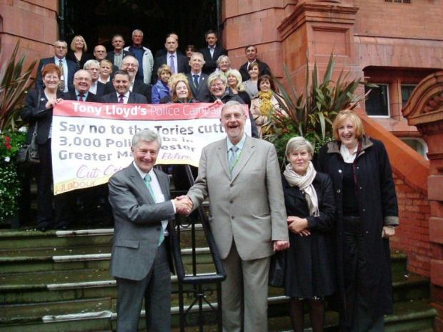 Tony Lloyd (front) left greeted by Lord Smith at Wigan Town Hall