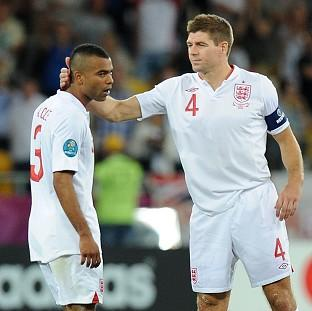 The Bolton News: Ashley Cole, left, and Steven Gerrard will make their 99th appearances for England on Tuesday