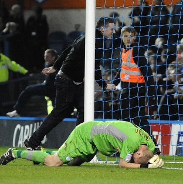 The Bolton News: Dave Jones called for Leeds fans to be banned after Chris Kirkland, pictured, was attacked