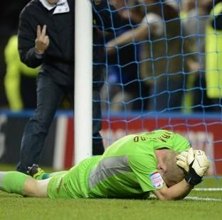Chris Kirkland lies on the ground after being attacked