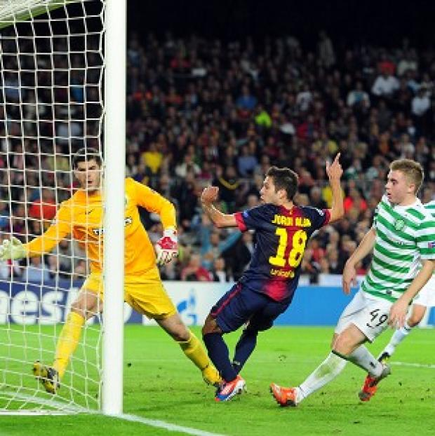 The Bolton News: Barcelona's Jordi Alba scores the winning goal