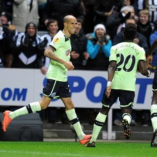 The Bolton News: Gabriel Obertan, left, celebrates scoring for Newcastle United against Brugge