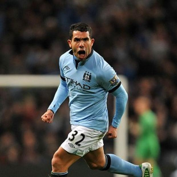 The Bolton News: Carlos Tevez proved the difference as Manchester City beat Swansea