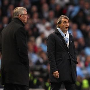 Roberto Mancini, right, has hit back at Sir Alex Ferguson's, left, penalty jibe