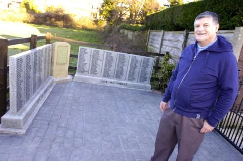Tony Hogan with the memorial stones in honour of those who lost their lives