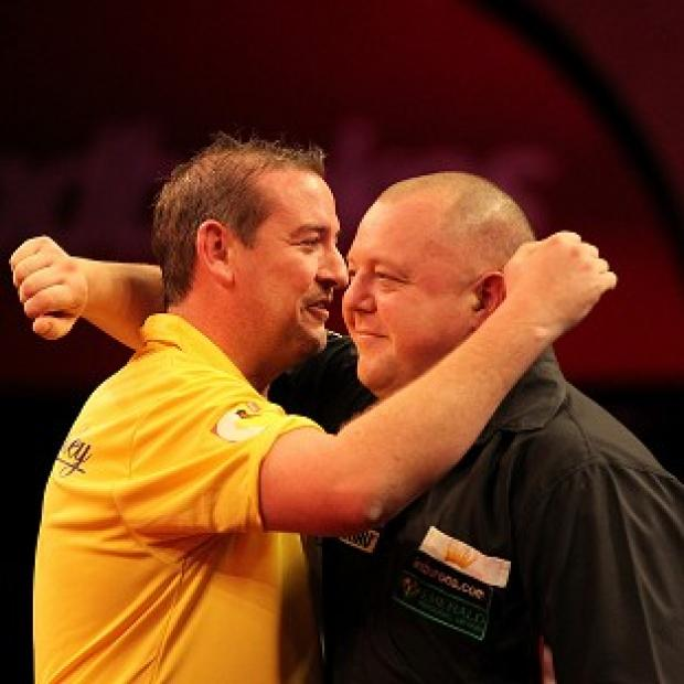 Dean Winstanley, left, embraces Mervyn King after his victory in a pulsating encounter