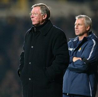 Sir Alex Ferguson, left, and Alan Pardew, right, go head to head on Boxing Day