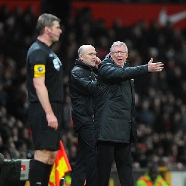 Sir Alex Ferguson, right, insists the officials made a 'bad decision' to award the own-goal