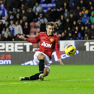 Robin van Persie scored twice as Manchester United beat Wigan