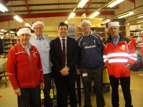 "MP Andy Burnham, centre, gave posties his vote during a visit to the Royal Mail delivery office in Leigh.    Praising the staff at the centre, he said: ""Six days a week, 52 weeks a year, in heat waves, floods and blizzards, the UK's postal workers are"