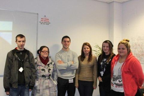 Retail and business course students with Toussaint Lebeugle, third from left