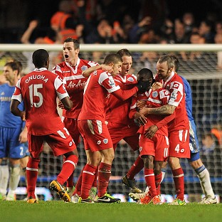 Shaun Wright-Phillips, second right, is mobbed by his team-mates after scoring the winner