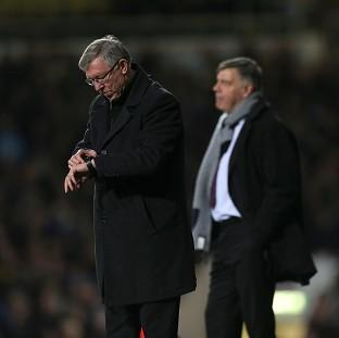 A late show from Alex Ferguson's, left, Manchester United sealed a replay