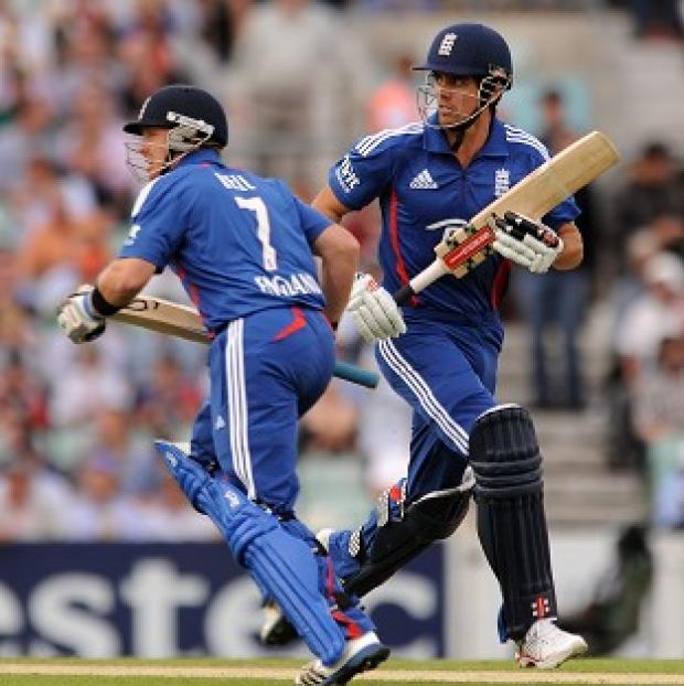 The Bolton News: Ian Bell, left and Alastair Cook, right, reached 74 without loss after 15 overs in the first ODI