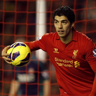 Sir Alex Ferguson claims Liverpool's Luis Suarez, pictured, attracts controversy