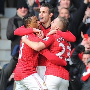 Robin van Persie, centre, celebrates with team-mates after breaking the deadlock in the first half