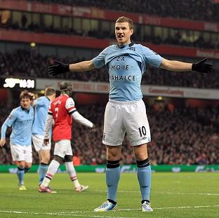 Edin Dzeko, centre right, displays a message on his t-shirt after scoring for Manchester City