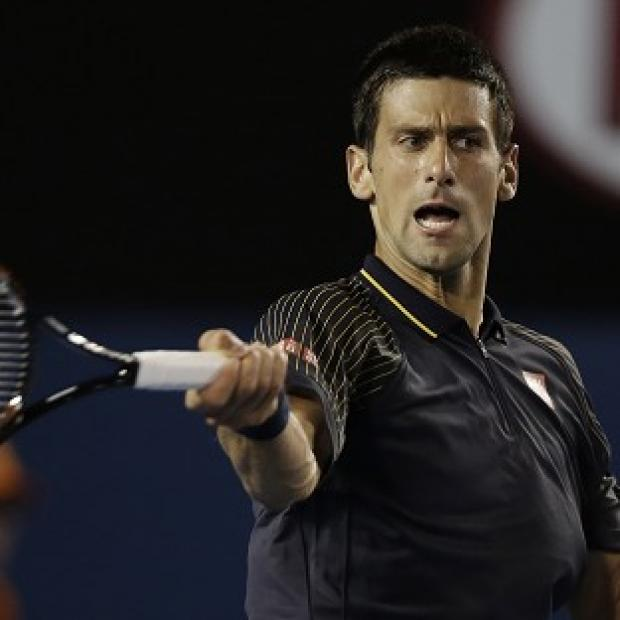 Novak Djokovic, pictured, eased past Ryan Harrison at the Australian Open (AP)