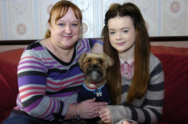 Brave Kim with her 'best buddy', Alfie, and her mum, Sue.
