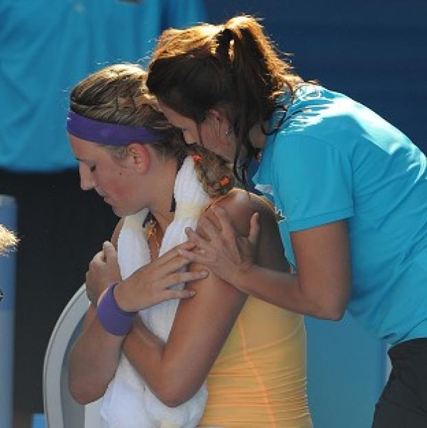 Victoria Azarenka receives treatment during the Australian Open semi-final (AP)