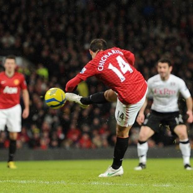 Javier Hernandez, centre, scores the first of his two goals for Manchester United against Fulham