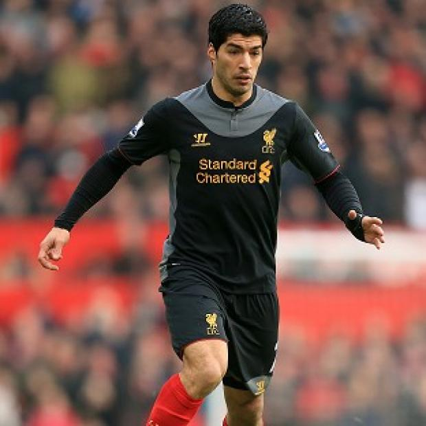 Brendan Rodgers has supported Luis Suarez, pictured, to the hilt this season