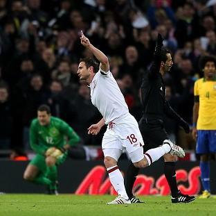 Frank Lampard celebrates scoring England's second goal of their friendly against Brazil