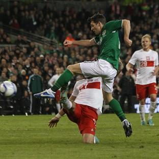 Wes Hoolahan, right, fires home the second goal of the game against Poland