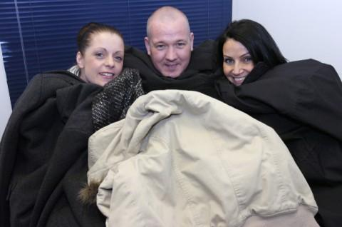 Jackie Cherriman, Mike Weaxall and Michelle Nuttall with donated coats at Adactus