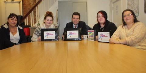 Lowton Girls Group members Samantha Lee and Georgina Hall with Wigan Council youth workers Deb Hall and Karen Freeman, and MP Andy Burnham