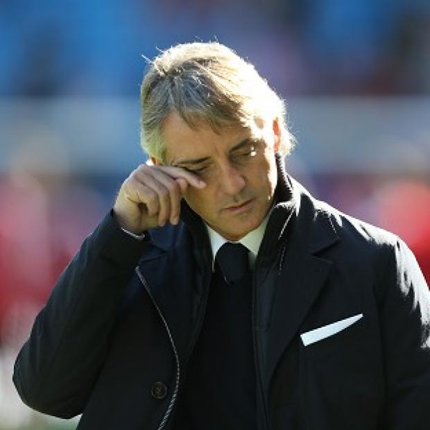 Manchester City boss Roberto Mancini insists the title race is not over