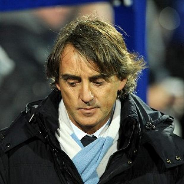 Manager Roberto Mancini admitted Manchester City will find it difficult to retain their title