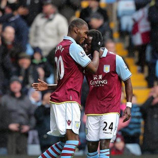 Christian Benteke, left, celebrates scoring Aston Villa's first goal of the game against West Ham