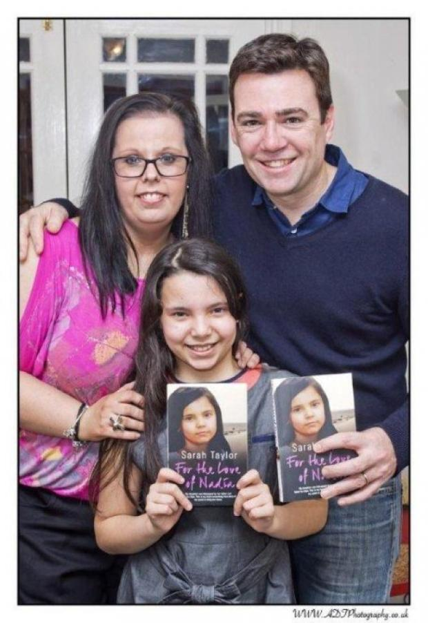 Author Sarah Taylor with daughter Nadia and the MP who helped reunite them, Andy Burnham.
